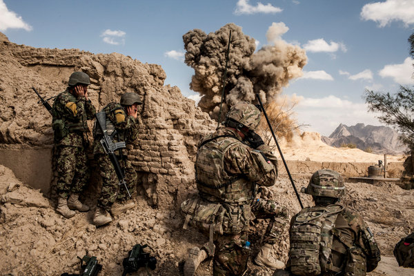 A part from being sujected to constant attack from the Taliban the US Military is also subjected to daily Powerpoint presentations. Photo Credit: Bryan Denton for The New York Times